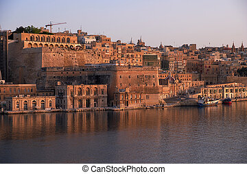 The early morning view of Valletta fortifications from the...