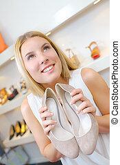 girl holding stilettos