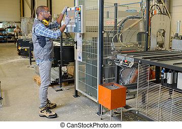 worker tending the machine