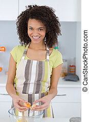 happy woman baking in her kitchen