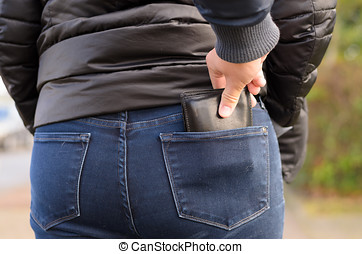 Pickpocket stealing a purse from a woman - Pickpocket...