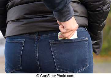 Pickpocket stealing cash from a woman