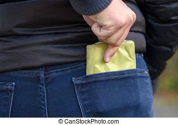 Pickpocket stealing a protruding purse from the back jeans...
