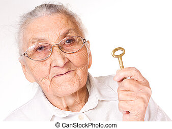old lady with a key in her hand - Old lady with an old key...