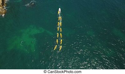 Aerial. Swimming lessonsin kayaks, for tourists. Ponta de...