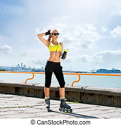 Young and sporty woman rollerblading on skates - Fit, sporty...