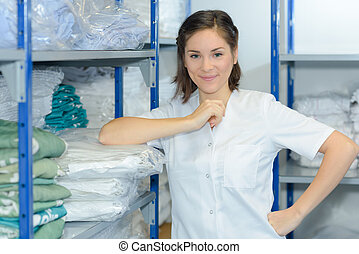 beautiful young woman working at laundry