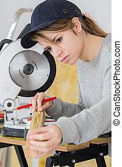 Female carpenter working