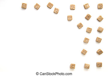 Brown sugar cubes on white background. Top view. Diet...