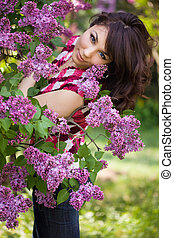 tender girl in the garden with lilac