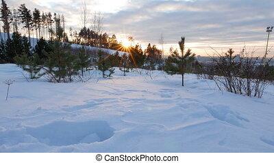 Setting sun in winter. Camera moves. UltraHD (4K)