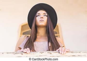 Commander - Portait of an elegant beautiful woman in hat...