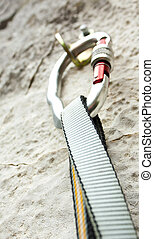 Be safe! - Climbing carabiner on rock wall