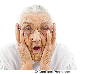 grandma with open mouth - portrait of a surprised old woman...