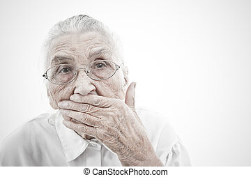 grandma is mute - portrait of a very old woman who is...