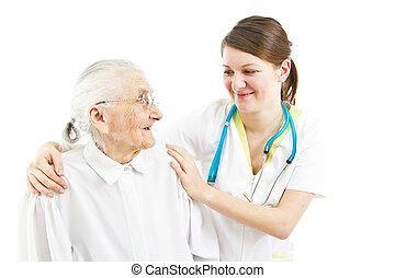 doctor taking care of an old lady - young female doctor is...