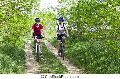 girls  biking in the forest