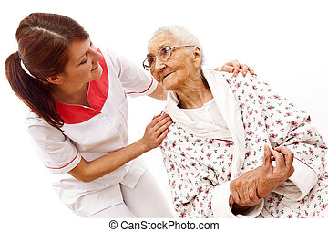 medical care for an old woman - Young female doctor caring...