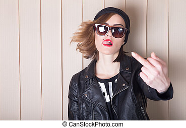 Middle finger - Beautiful lady in leather jacket showing...