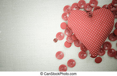 Loving copy space - Sewed heart with red buttons and copy...