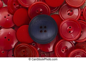 Dare to differ - One black button among many similar red...