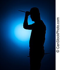 silhouette Expressive young drummer with drum stick on a...
