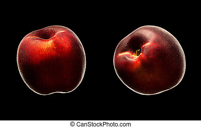 Ripe fresh nectarine peach isolated on black background.