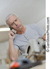 Man on telephone, exasperated expression