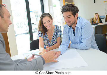 Couple in discusison with agent