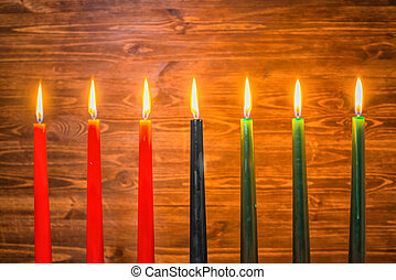 Kwanzaa festival concept with seven candles red, black and...