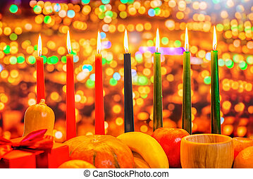 Kwanzaa celebration concept with seven candles red, black...