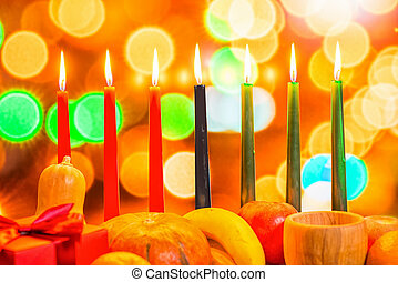african Kwanzaa festive concept with decorate seven candles...