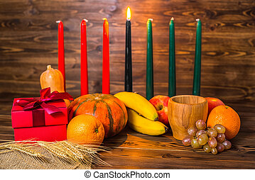african Kwanzaa festive concept with decorative candles red,...