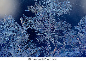 Frost on window - Abstract ice pattern on winter glass