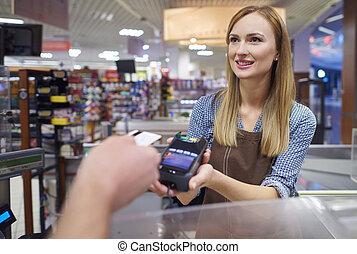 Woman took a contactless payment