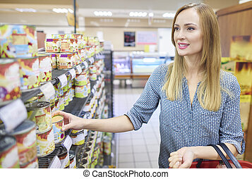 Hesitant woman choosing proper products