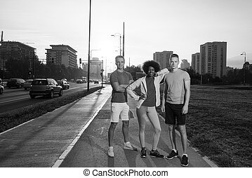 portrait multiethnic group of people on the jogging -...