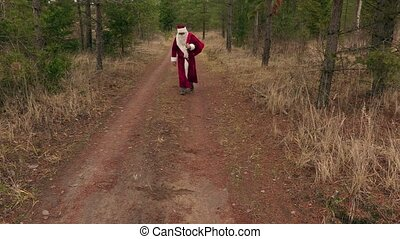 Santa Claus walking and says ho, ho, ho