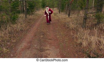 Santa Claus walking and says ho, ho, ho