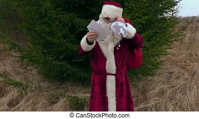 Santa Claus reading letters and walking away