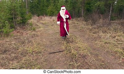 Santa claus walking and say goodbye to forest