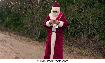 Santa Claus with gift bag and apple