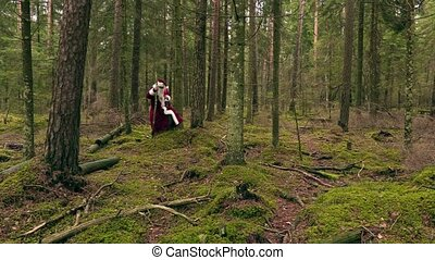 Santa Claus with gift bag in the forest