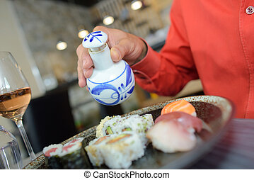 eating sushi in the restaurant