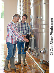 Wine producers in vat room