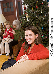 Three generations - happy mother at Christmas with boy and...