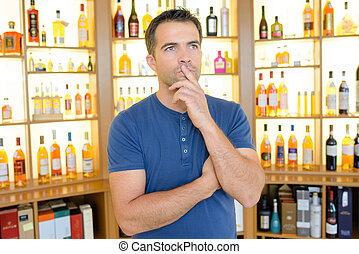 Pensive man in liquor store