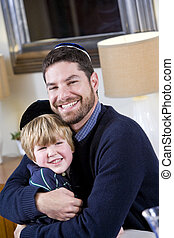 Jewish father and young son wearing yarmulkes - Loving...