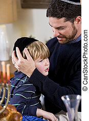 Father and boy celebrating Hanukkah - Affectionate father...
