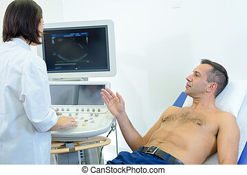 Man having scan talking to nurse